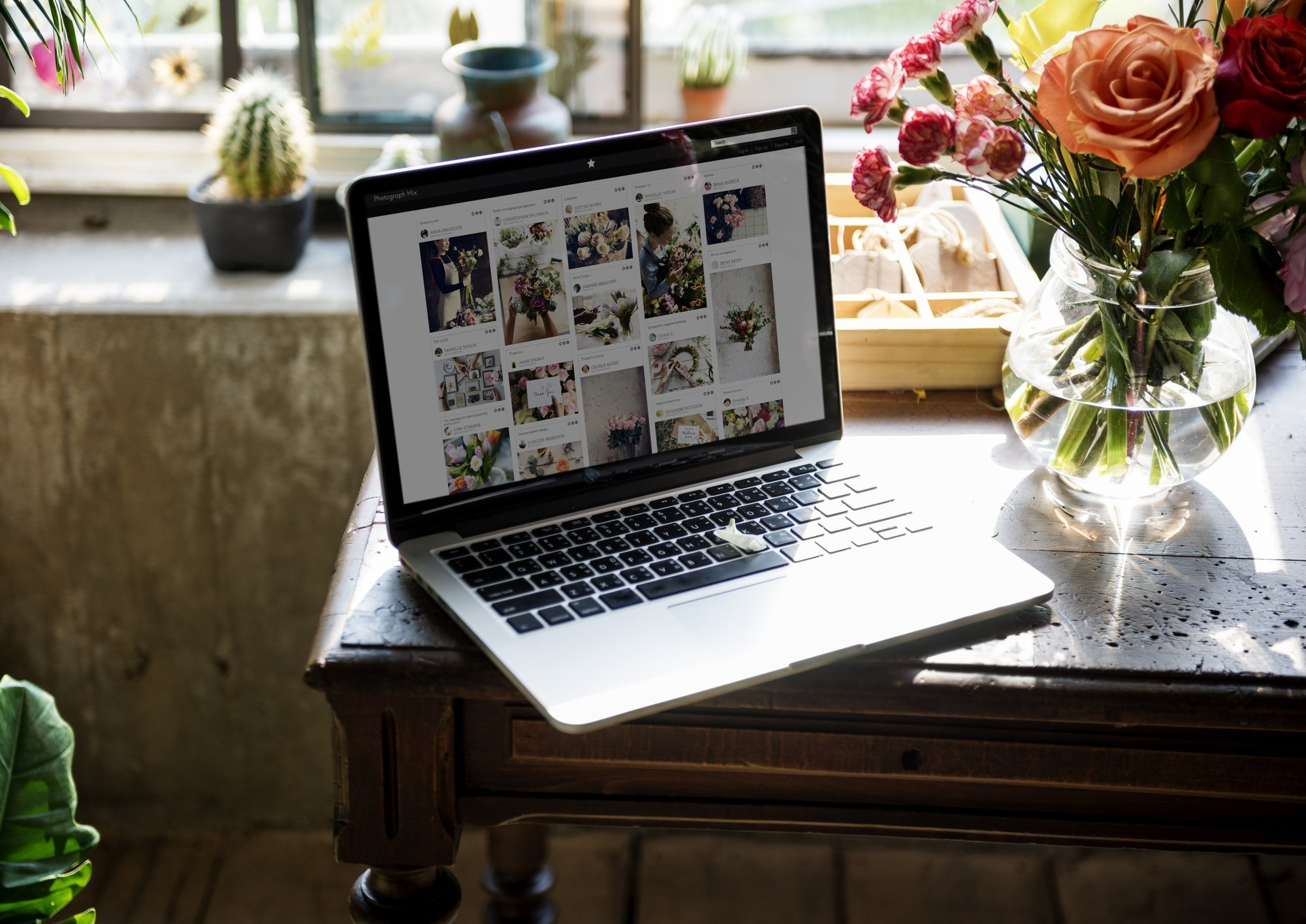 laptop and flowers - Capstone Digital Marketing