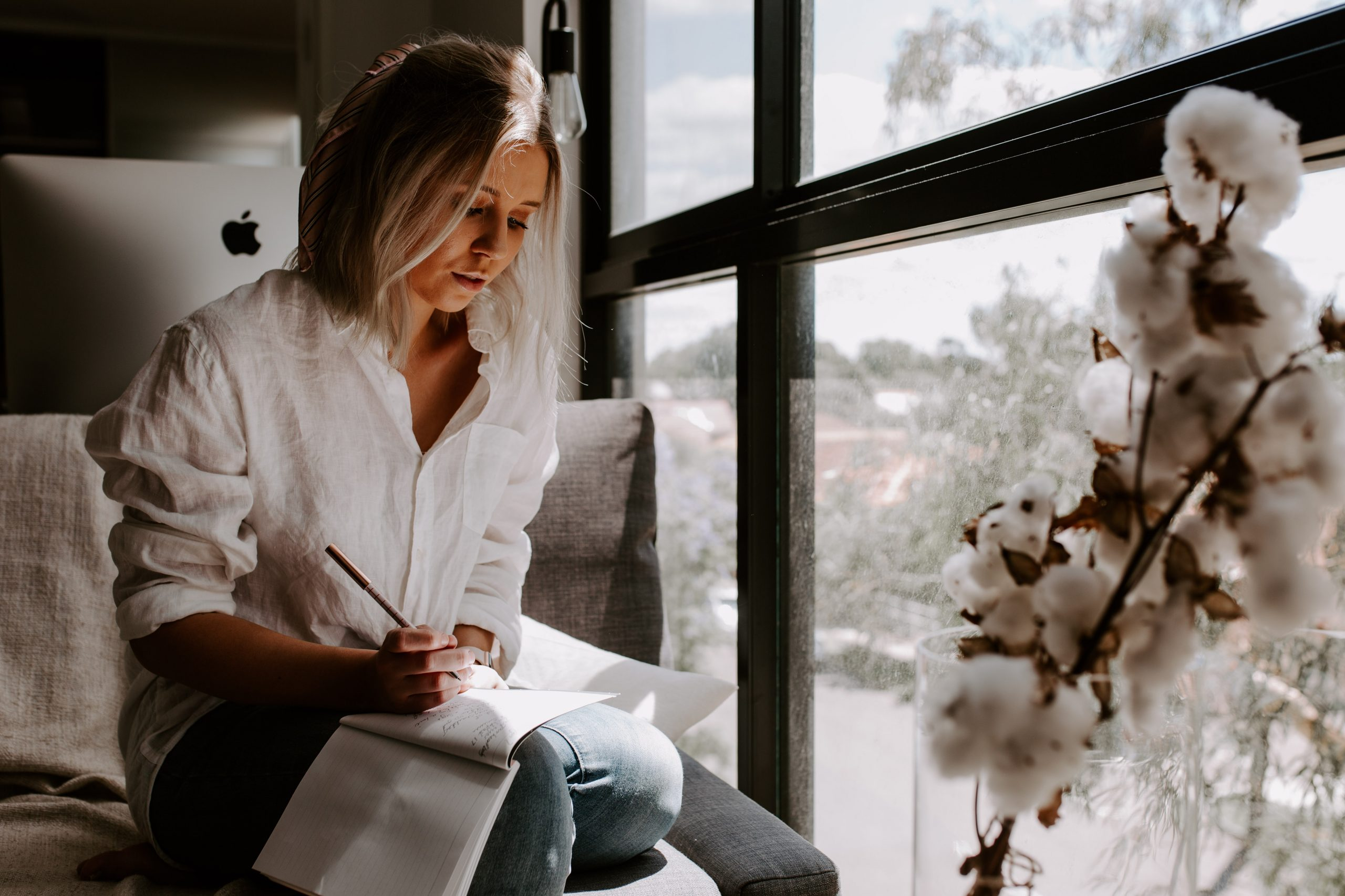 woman writing in a window - Capstone Digital Marketing